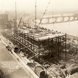 Sepia-toned photograph dated March 3, 1931, showing Moyer Judicial Center under construction.